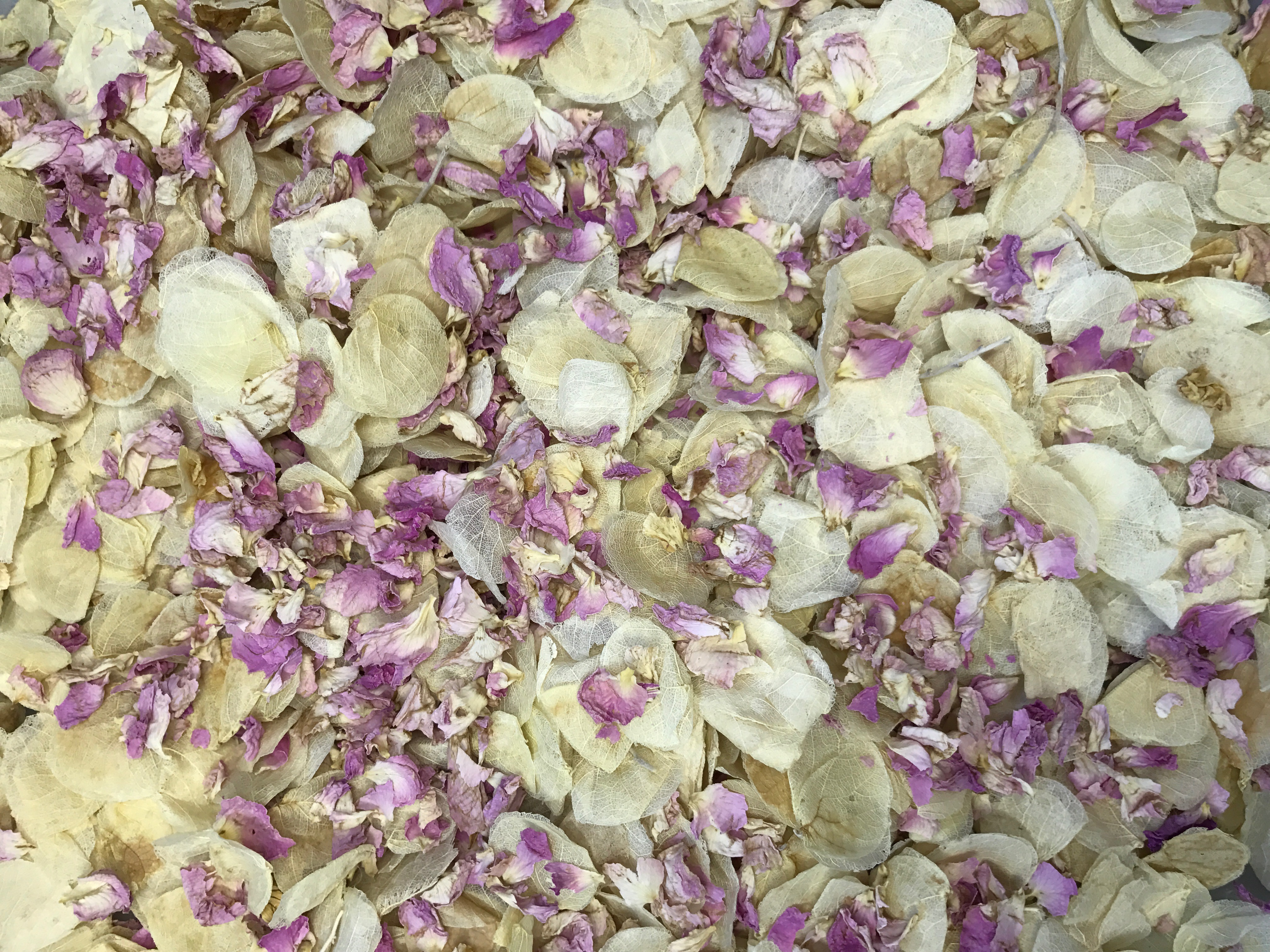 real petal and dried flower throwing wedding confetti